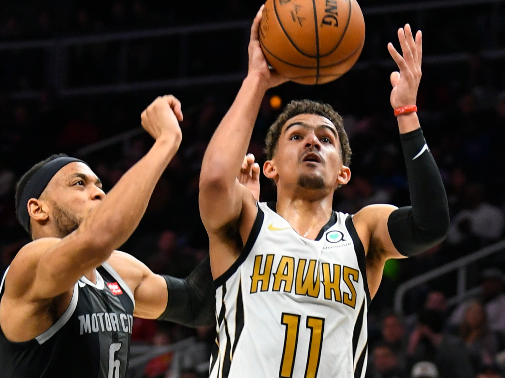 Atlanta Hawks guard Trae Young shoots as Detroit Pistons guard Bruce Brown (6) defends during the first half of an NBA basketball game Friday, Feb. 22, 2019, in Atlanta.