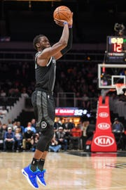 Detroit Pistons guard Reggie Jackson (1) shoots the ball against the Atlanta Hawks during the first half at State Farm Arena on Feb. 22, 2019.