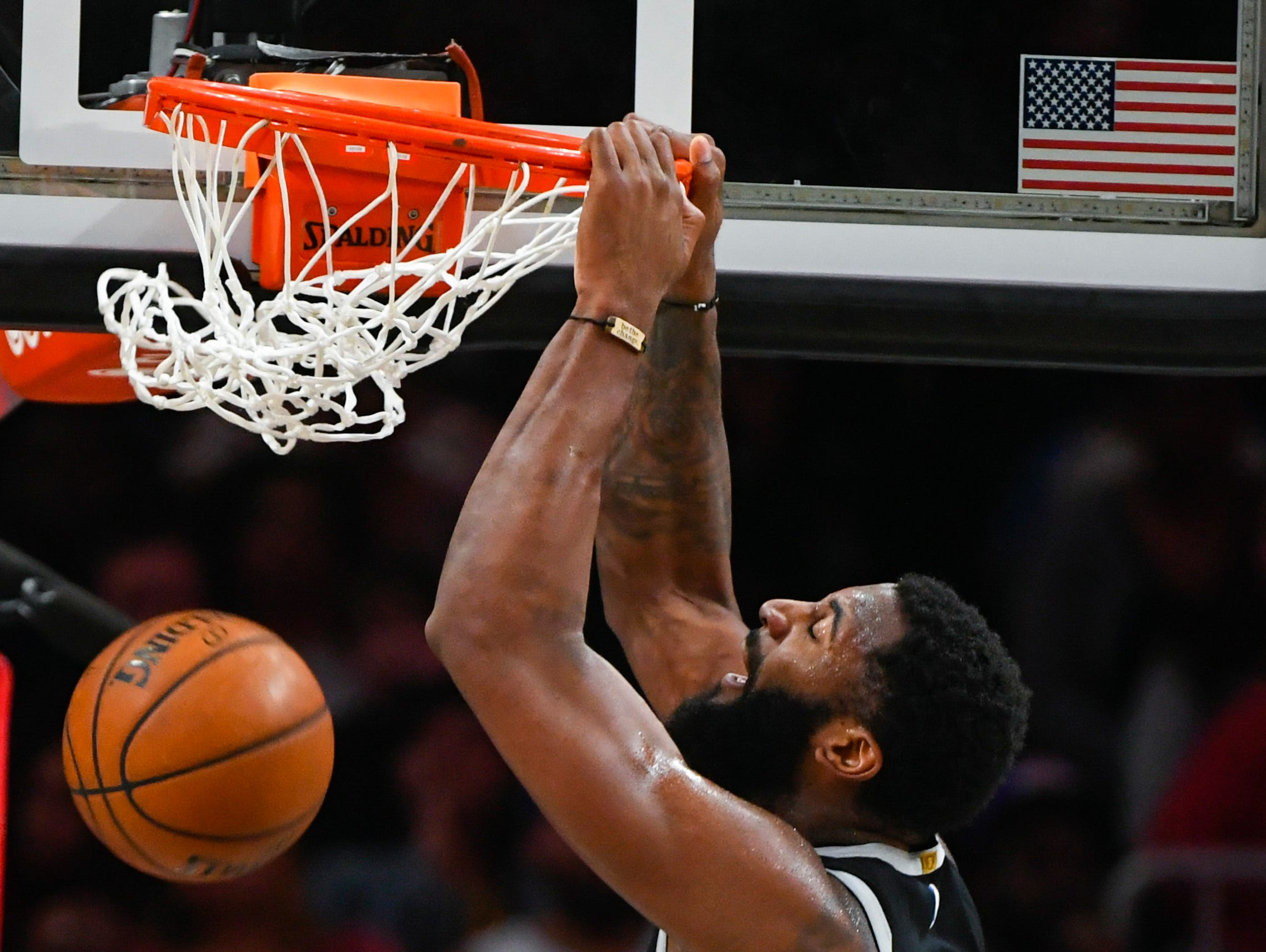 Detroit Pistons center Andre Drummond dunks against the Atlanta Hawks during the first half of an NBA basketball game, Friday, Feb. 22, 2019, in Atlanta.