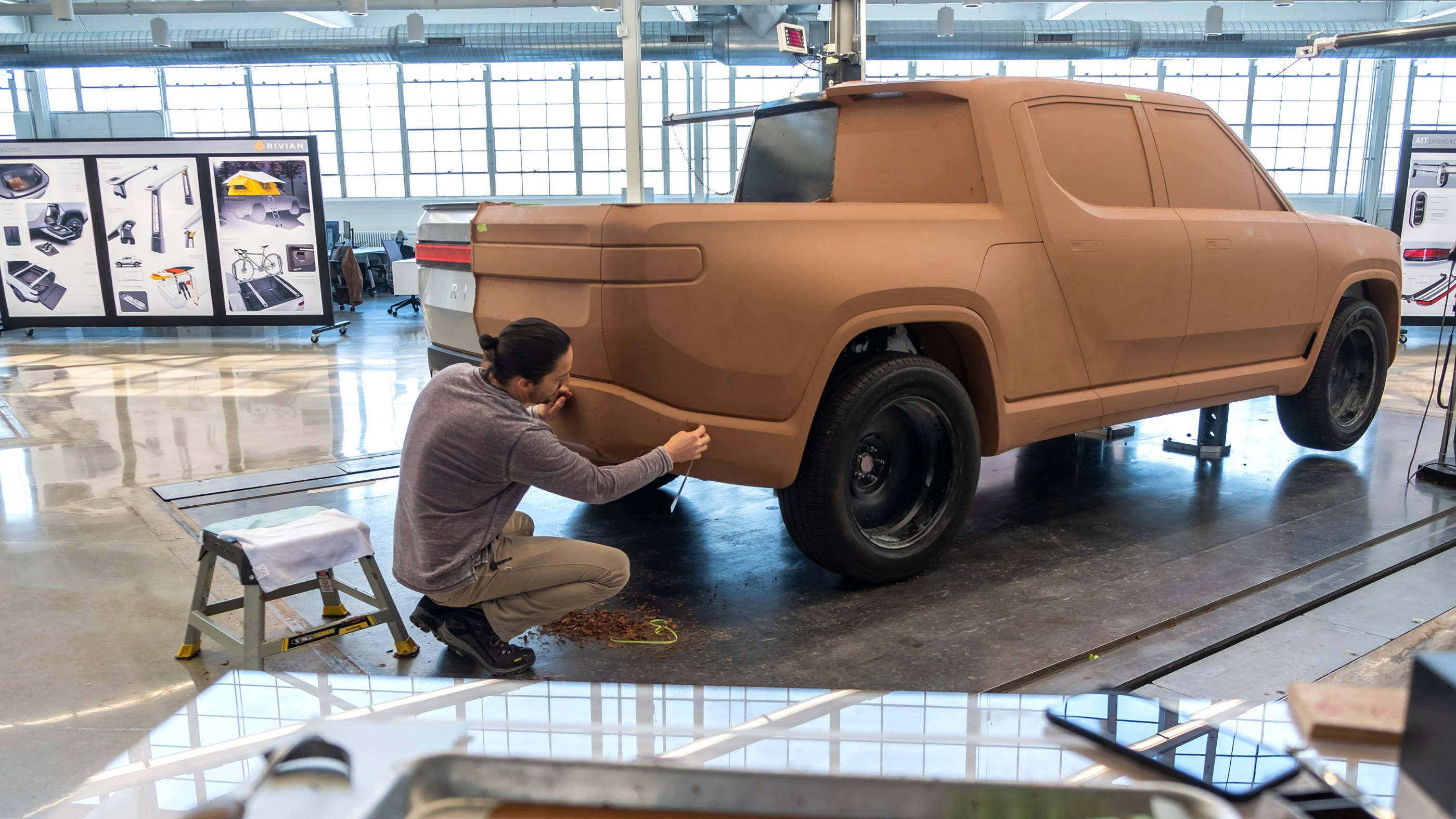 Amazon led $700 million in funding for electric-vehicle startup Rivian, but talks with GM reportedly broke down.