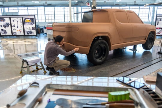 Rivian Lead Design Sculptor Andrew Frierott works on design development for an R1T electric vehicle at the startup in Plymouth on Thursday, February 21, 2019.