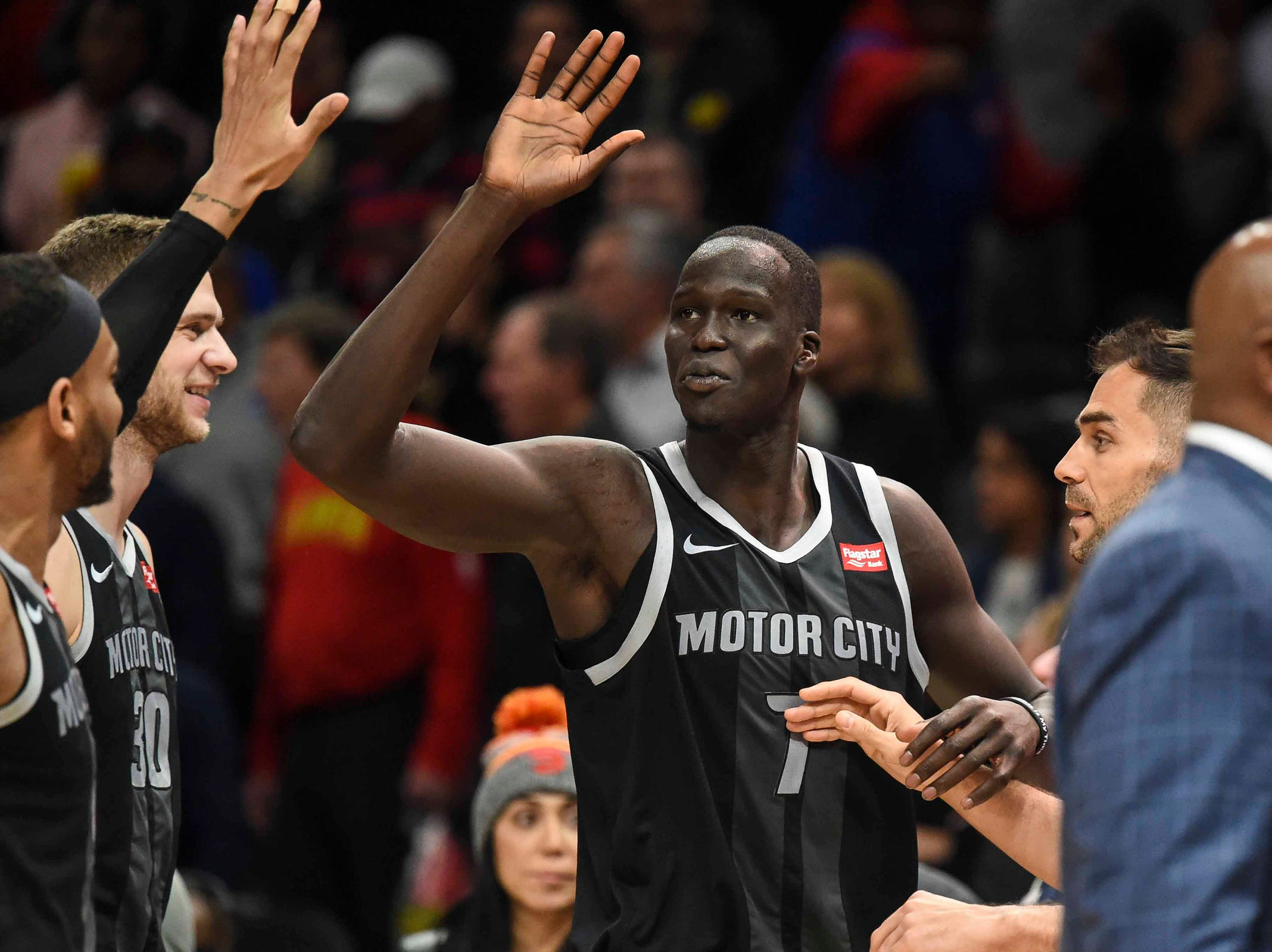 Detroit Pistons forward Thon Maker (7) reacts with teammates after making a three point basket to give the Pistons the lead with sixteen seconds left against the  Atlanta Hawks during the second half at State Farm Arena on Feb. 22, 2019.