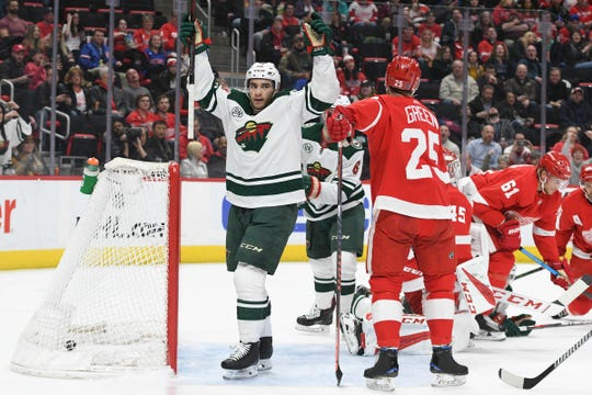 Minnesota Wild center Luke Kunin (19) celebrates after scoring a goal past Detroit Red Wings goaltender Jonathan Bernier (45) during the first period at Little Caesars Arena on Feb. 22, 2019.