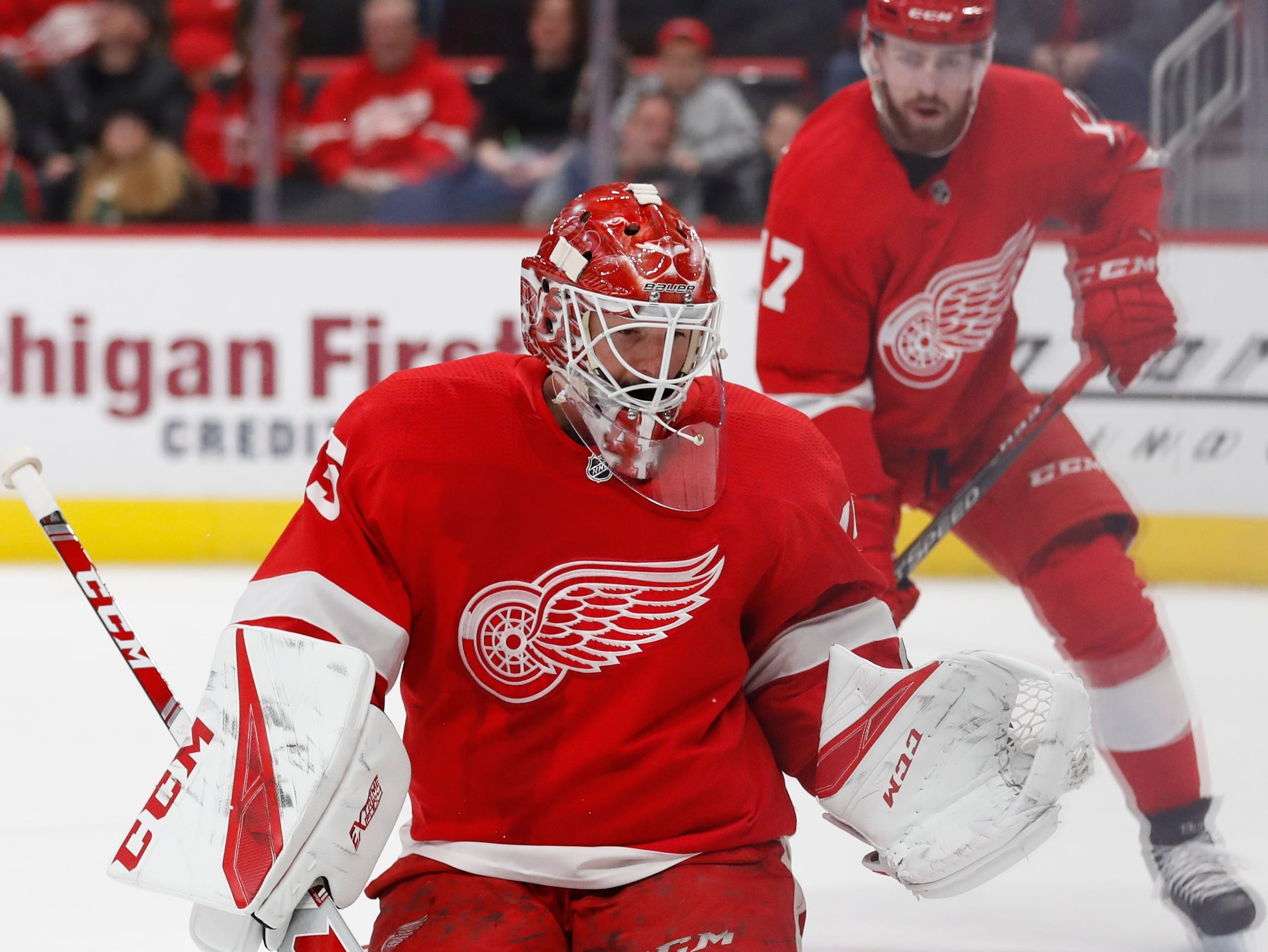 Detroit Red Wings goaltender Jonathan Bernier deflects a shot during the second period of an NHL hockey game against the Minnesota Wild, Friday, Feb. 22, 2019, in Detroit.