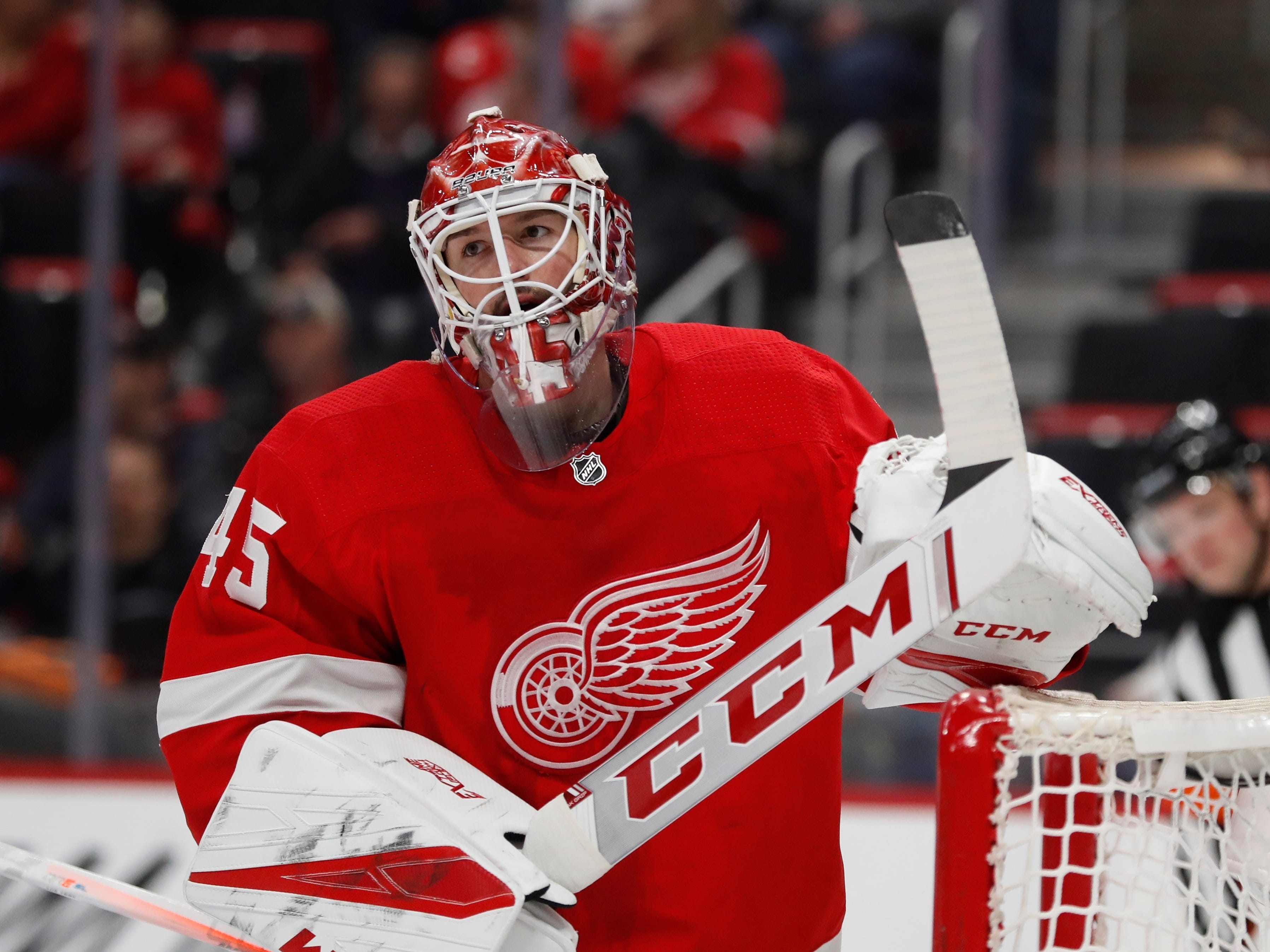 Detroit Red Wings goaltender Jonathan Bernier waits for play to resume after giving up a goal to Minnesota Wild center Eric Staal during the second period of an NHL hockey game, Friday, Feb. 22, 2019, in Detroit.