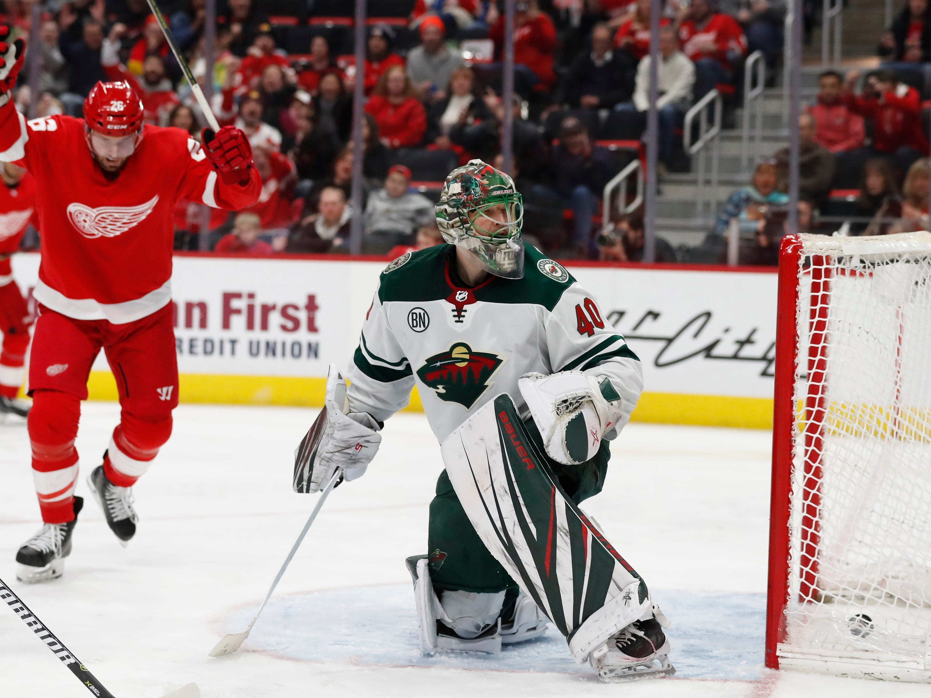 Detroit Red Wings left wing Thomas Vanek, left, reacts as a shot by right wing Anthony Mantha gets past Minnesota Wild goaltender Devan Dubnyk during the third period of an NHL hockey game Friday, Feb. 22, 2019, in Detroit.