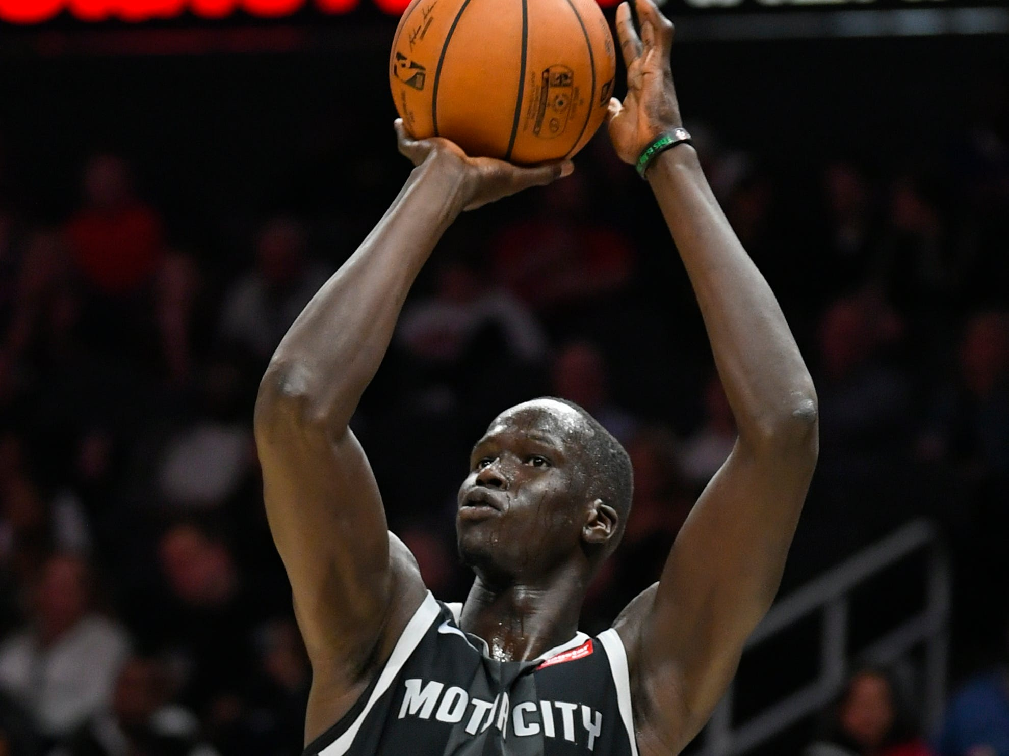 Detroit Pistons forward Thon Maker puts up a jump shot against the Atlanta Hawks during the second half of an NBA basketball game Friday, Feb. 22, 2019, in Atlanta.