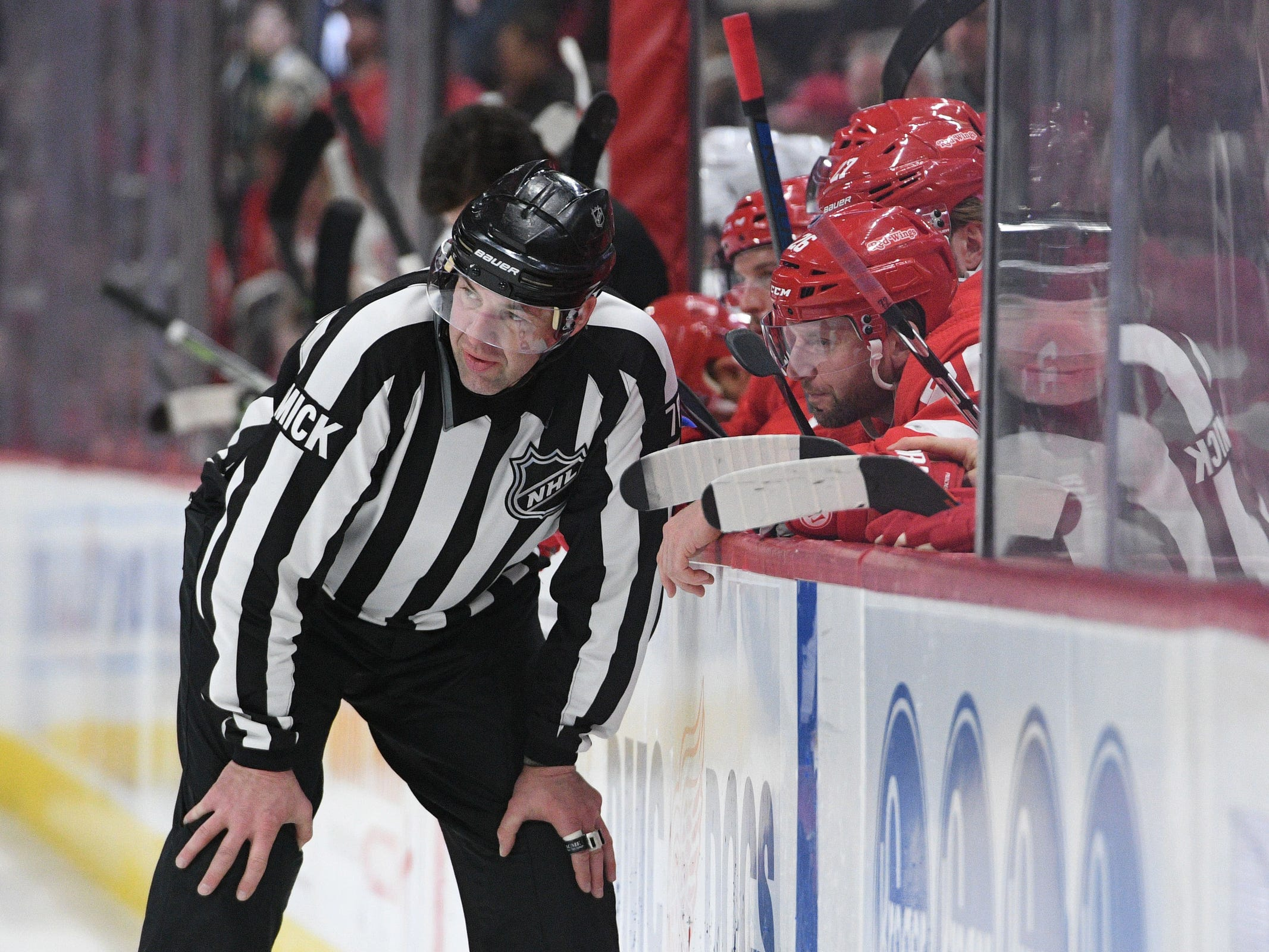 NHL linesman Brian Mach (78) talks to Detroit Red Wings left wing Thomas Vanek (26) during the game against the Minnesota Wild at Little Caesars Arena on Feb. 22, 2019.