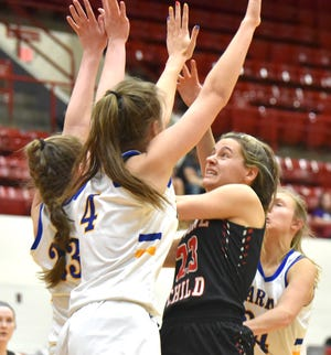 Divine Child's Maddie Rzepka(23) drives against a host of Marian defenders.