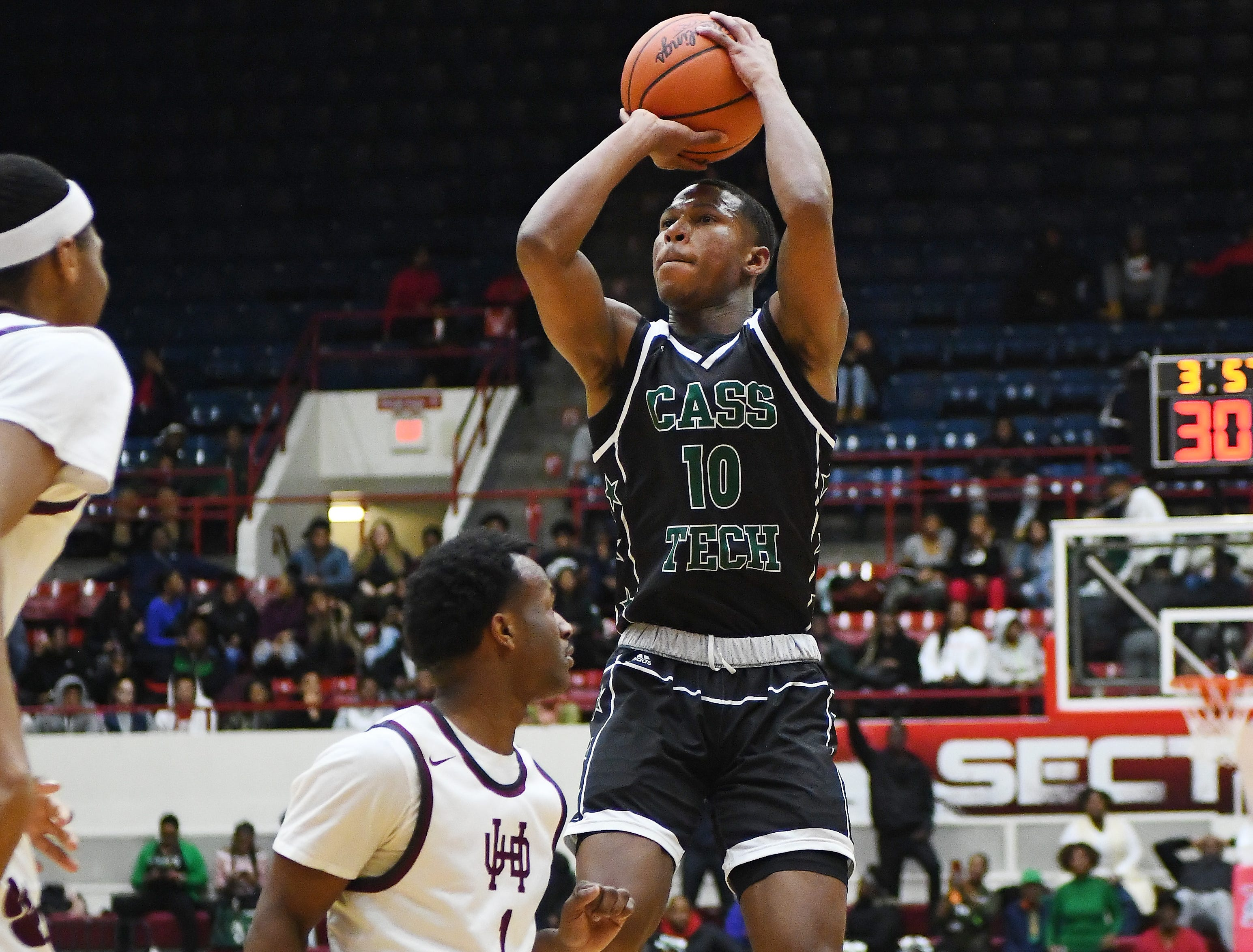 Cass Tech's Michael Washington-Hill puts up a long shot in the first half of the championship game.