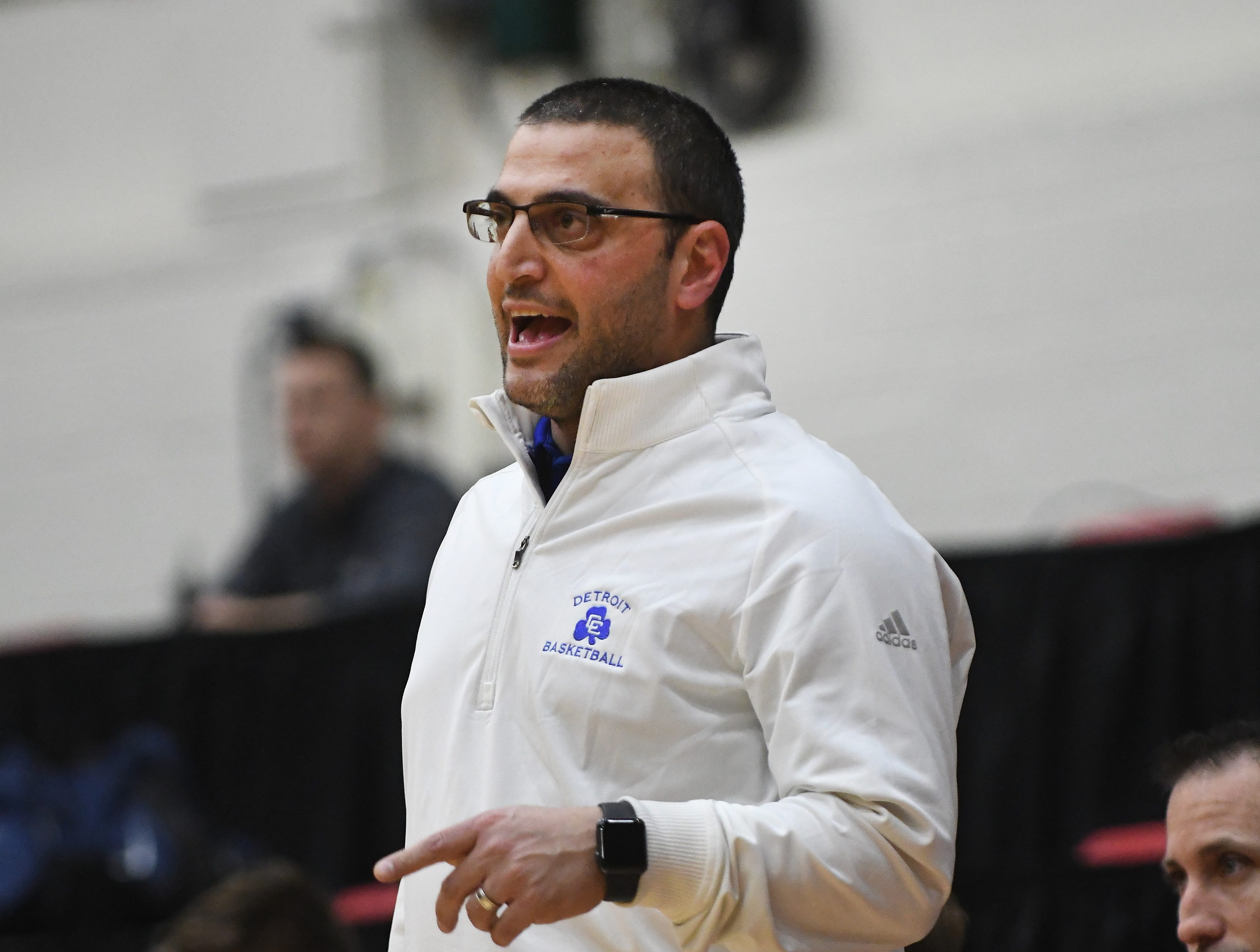 Catholic Central's head coach Brandon Sinawi calls out to his players in the first half of the consolation game.