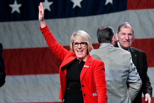 Former Livonia State Rep. Laura Cox, who is running for the Michigan Republican Chair, acknowledges the crowd after accepting her nomination during the MIGOP State Convention, Saturday, Feb. 23, 2019, at the Lansing Center.