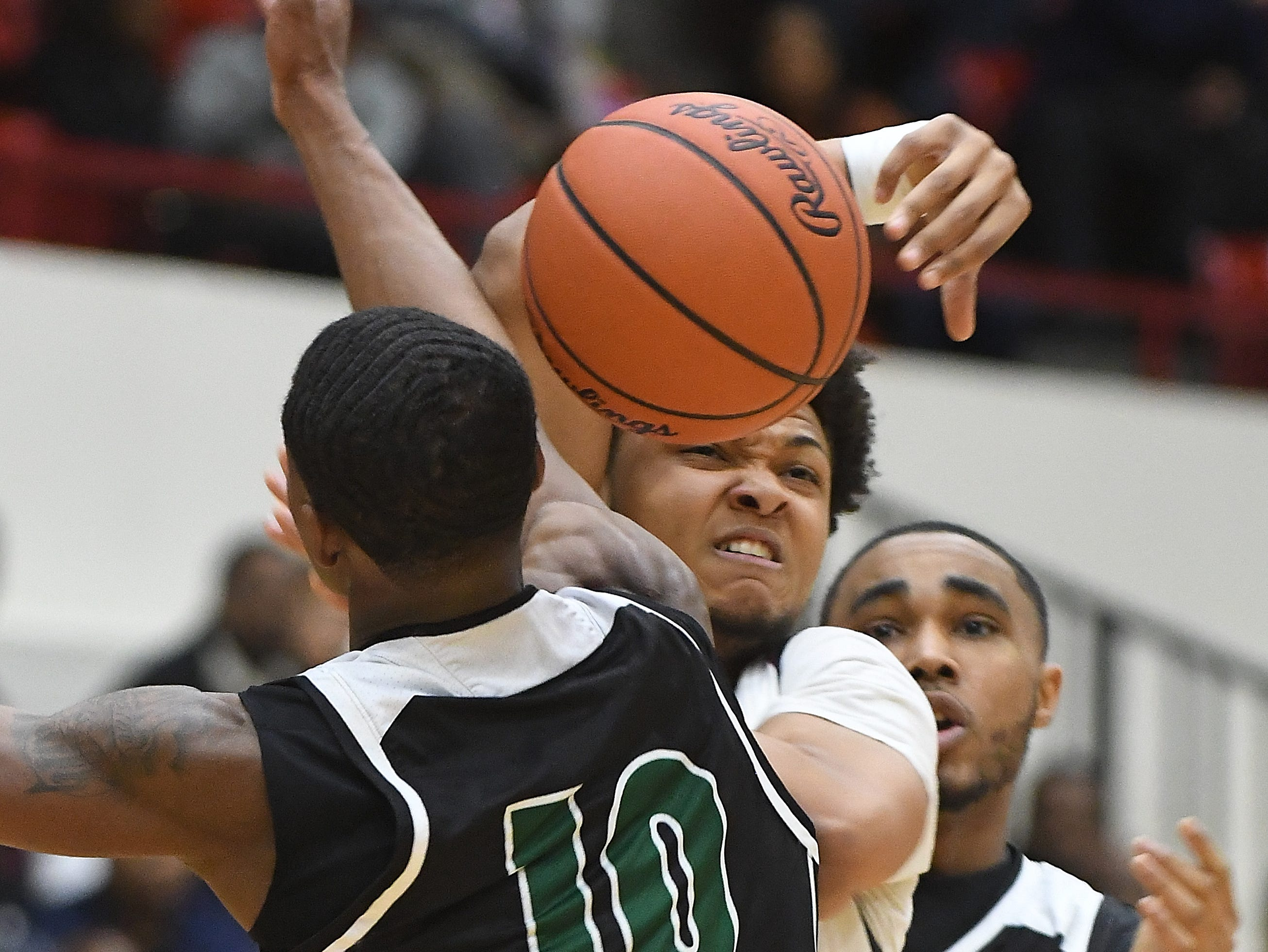 Cass Tech's Michael Washington Hill defends against  U of D Jesuit's Daniel Friday in the first half of the Operation Friendship championship game between Cass Tech and U. Of D. Jesuit at Calihan Hall on the campus of the University of Detroit Mercy in Detroit, Michigan on February 22, 2019.