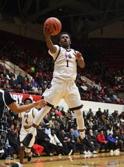 U-D Jesuit's Julian Dozier drives to the basket in the second half. Dozier finished with 23 pionts in a 79-59 victory over Detroit Cass Tech in the annual Operation Friendship game Friday.