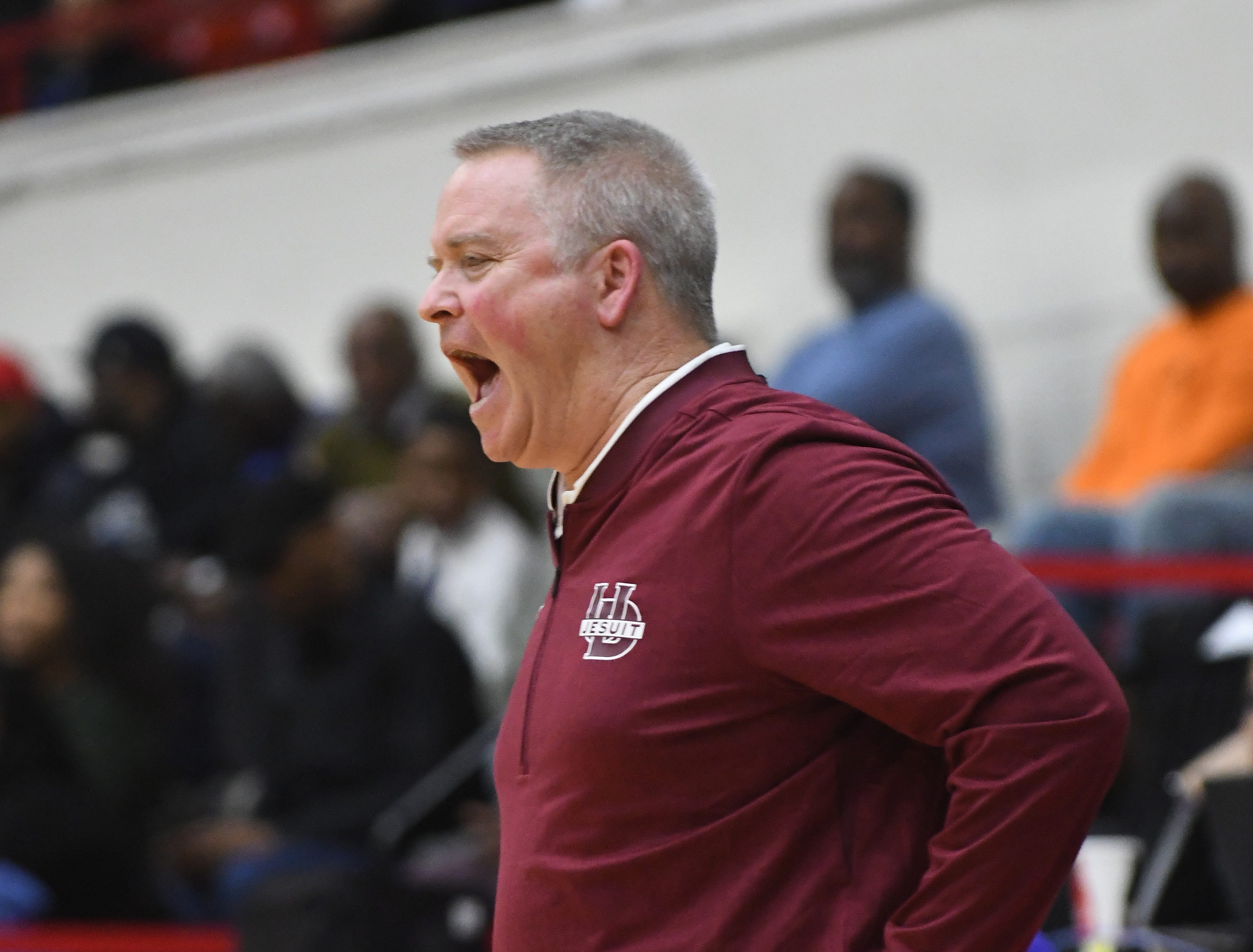 U of D Jesuit head coach Pat Donnelly yells out to his players in the first half.