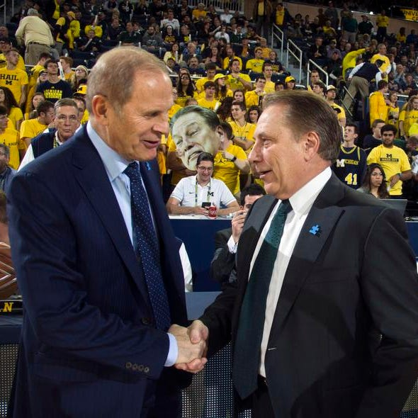 They are rivals on the court, but Michigan's John...