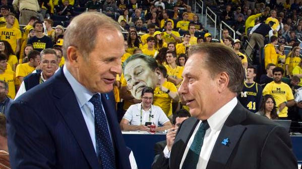 They are rivals on the court, but Michigan's John Beilein, left, and Michigan State's Tom Izzo have a cordial relationship.