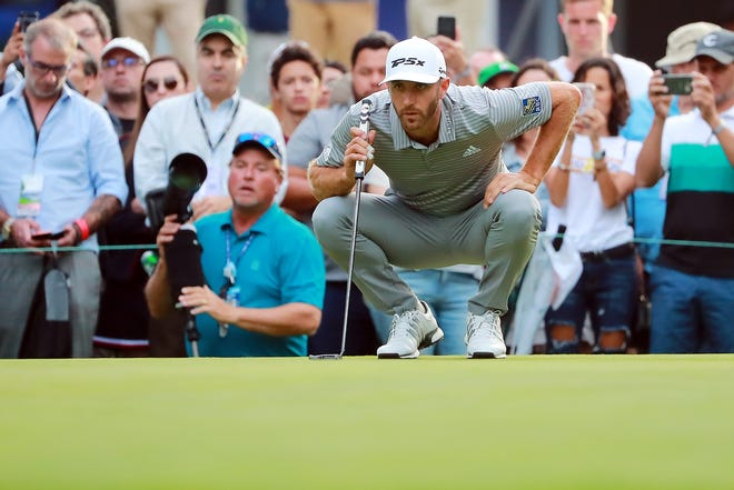 Dustin Johnson lines up a putt on the 18th green during the second round of World Golf Championships-Mexico Championship.