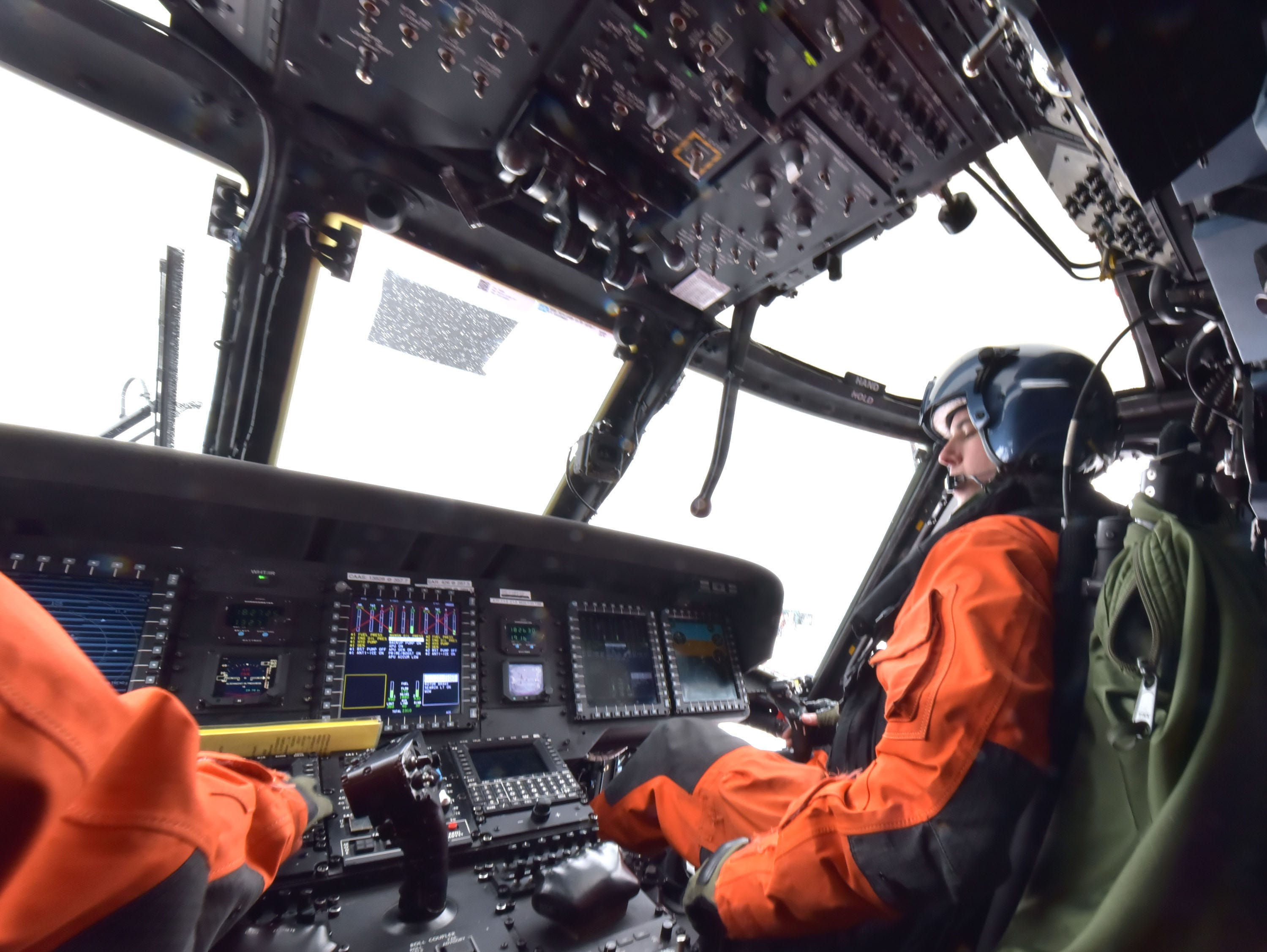 U.S. Coast Guard Lt. Andrew Chevalier flies a MH-60T Jayhawk helicopter Thursday, Feb. 14, 2019 while on Aids to Navigation flight. Two maintenance specialists were lowered to the deck of the White Shoal Lighthouse in upper Lake Michigan to perform maintenance and repair work on the light.