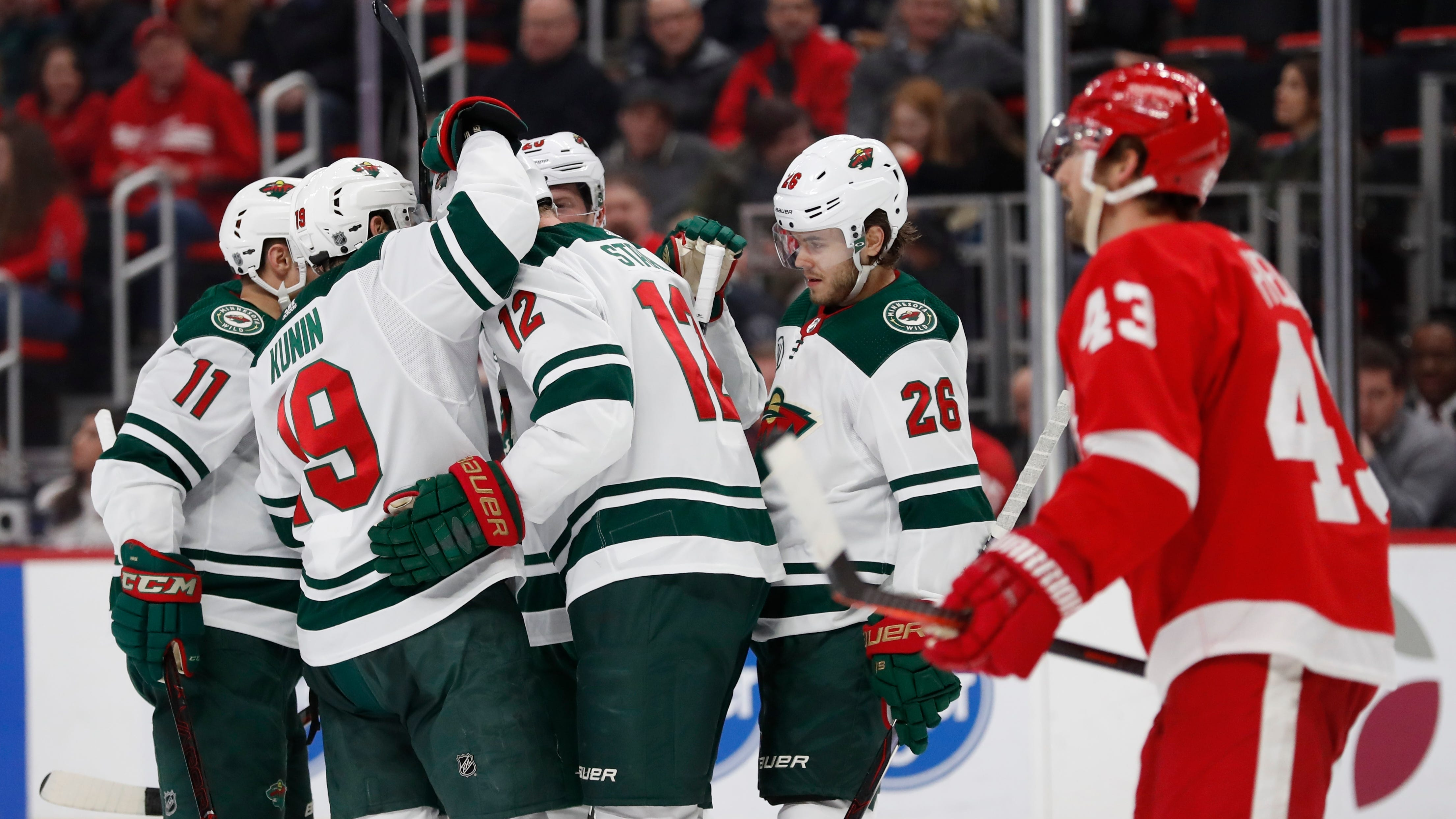 Minnesota Wild center Eric Staal (12) is congratulated by teammates as Detroit Red Wings left wing Darren Helm (43) skates by during the second period.
