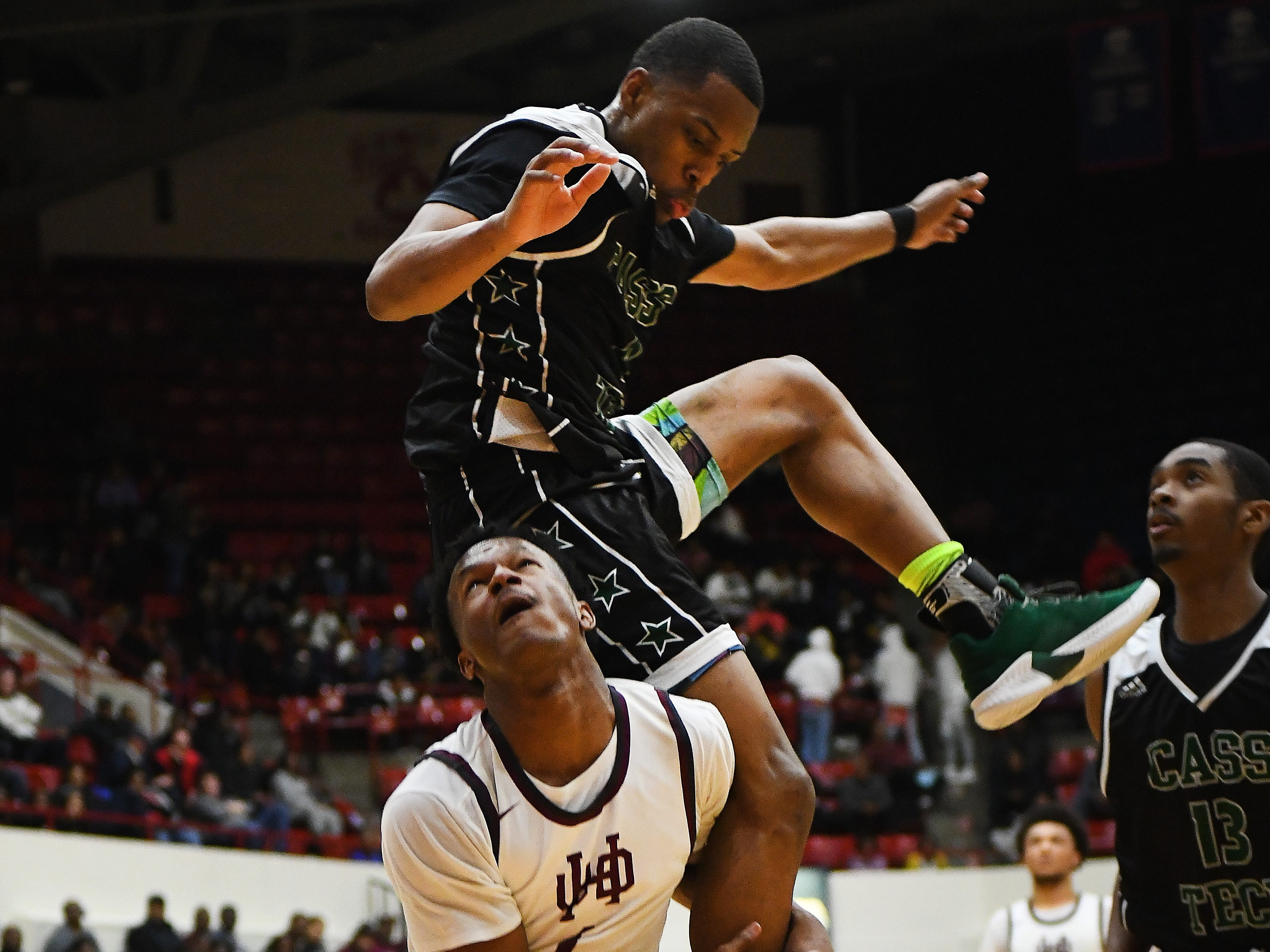 What goes up must come down as Cass Tech's Kyle Legrair discovers going up for the ball but crashing down over U of D Jesuit's Julian Dozier in the second half.