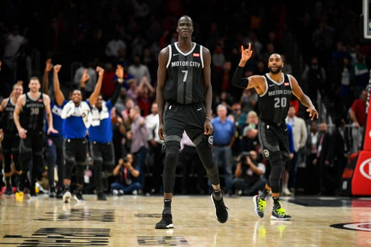 Detroit Pistons forward Thon Maker (7) looks on after hitting a winning 3-point basket as teammates celebrate during the final seconds.