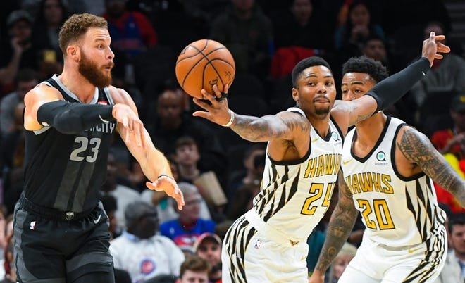 Atlanta Hawks guard Kent Bazemore (24) gets his hand on a pass by Detroit Pistons forward Blake Griffin (23) for a steal.