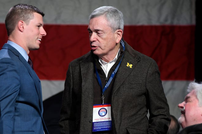 Outgoing Michigan Republican Party Chairman Ron Weiser, right, chats with House Speaker Lee Chatfield, Saturday, Feb. 23, 2019, at the MIGOP State Convention at the Lansing Center.