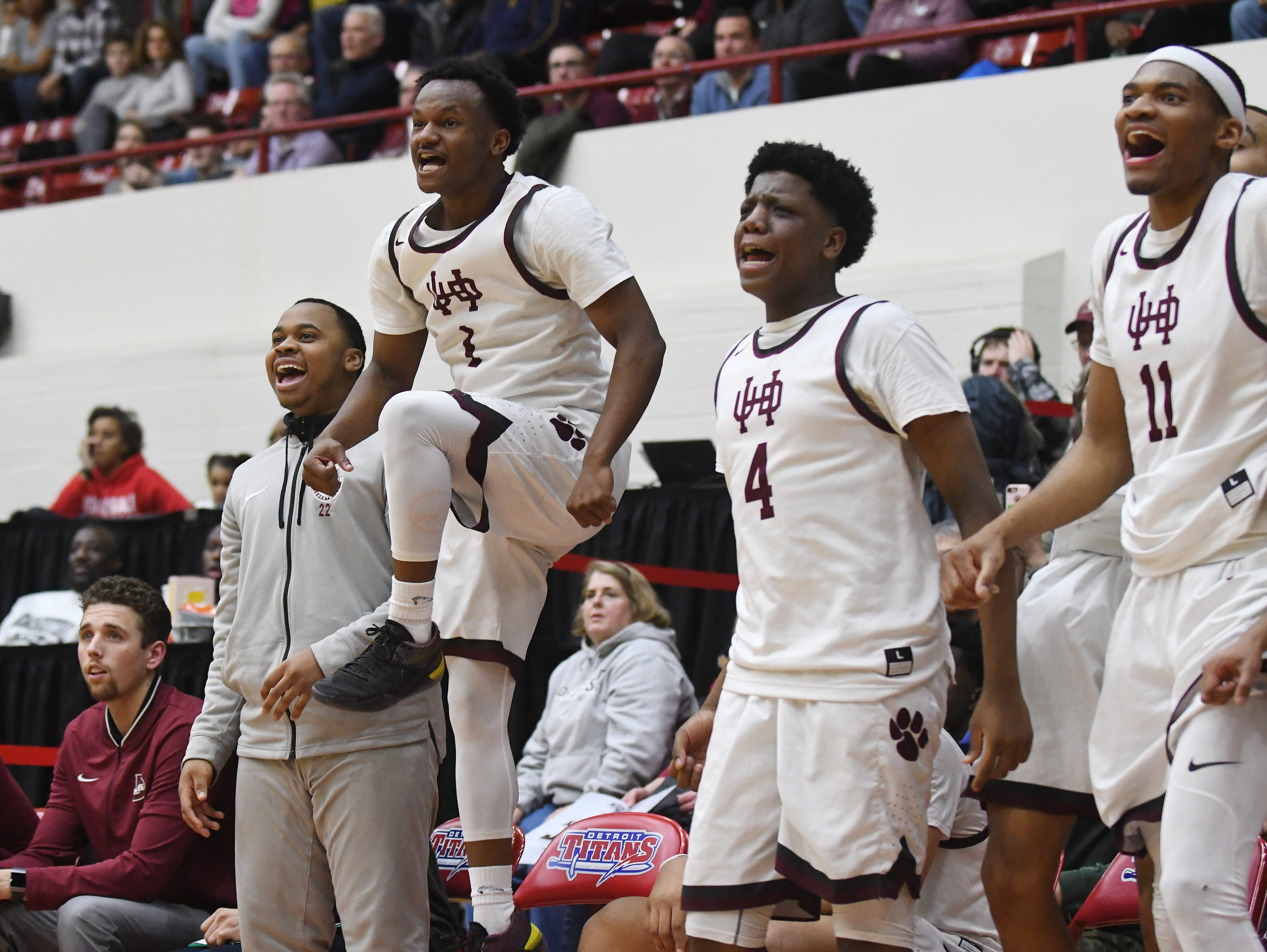 U of D Jesuit's bench erupts including Julian Dozier, Isaiah Friday and Jalen Thomas as a basket is made with the second team late in the second half of the Operation Friendship championship game.