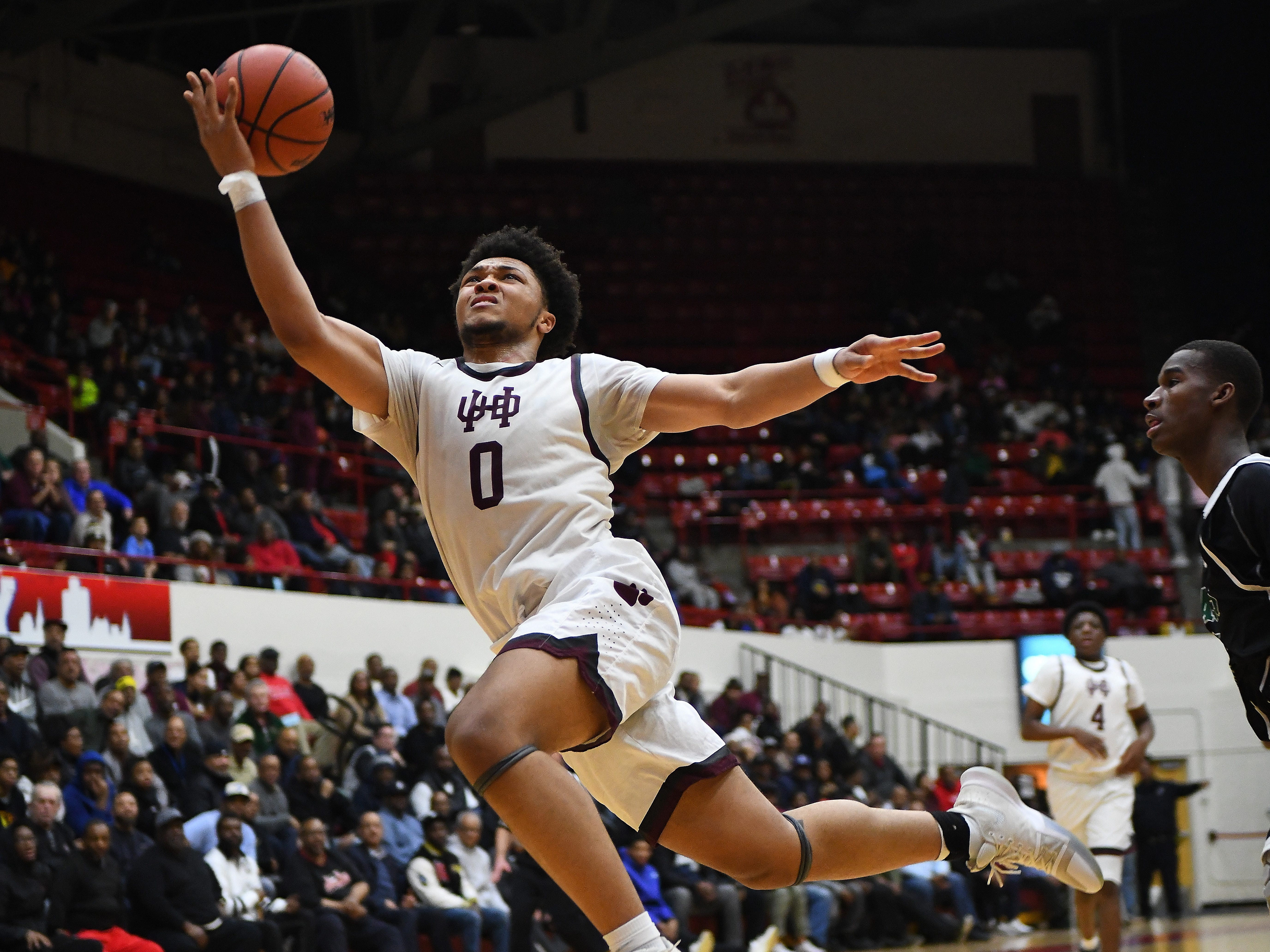 U of D Jesuit's Daniel Friday is fouled driving to the basket at the end of the third quarter.