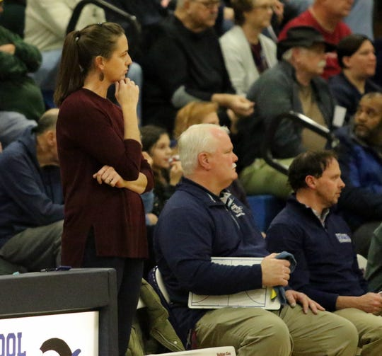 Alicia Learn coaches from the sideline along with Harold Chaffee, center, and Scott Morse during Watkins Glen's 61-35 win over Delhi in a Section 4 Class C quarterfinal Feb. 22, 2019 at Watkins Glen High School.
