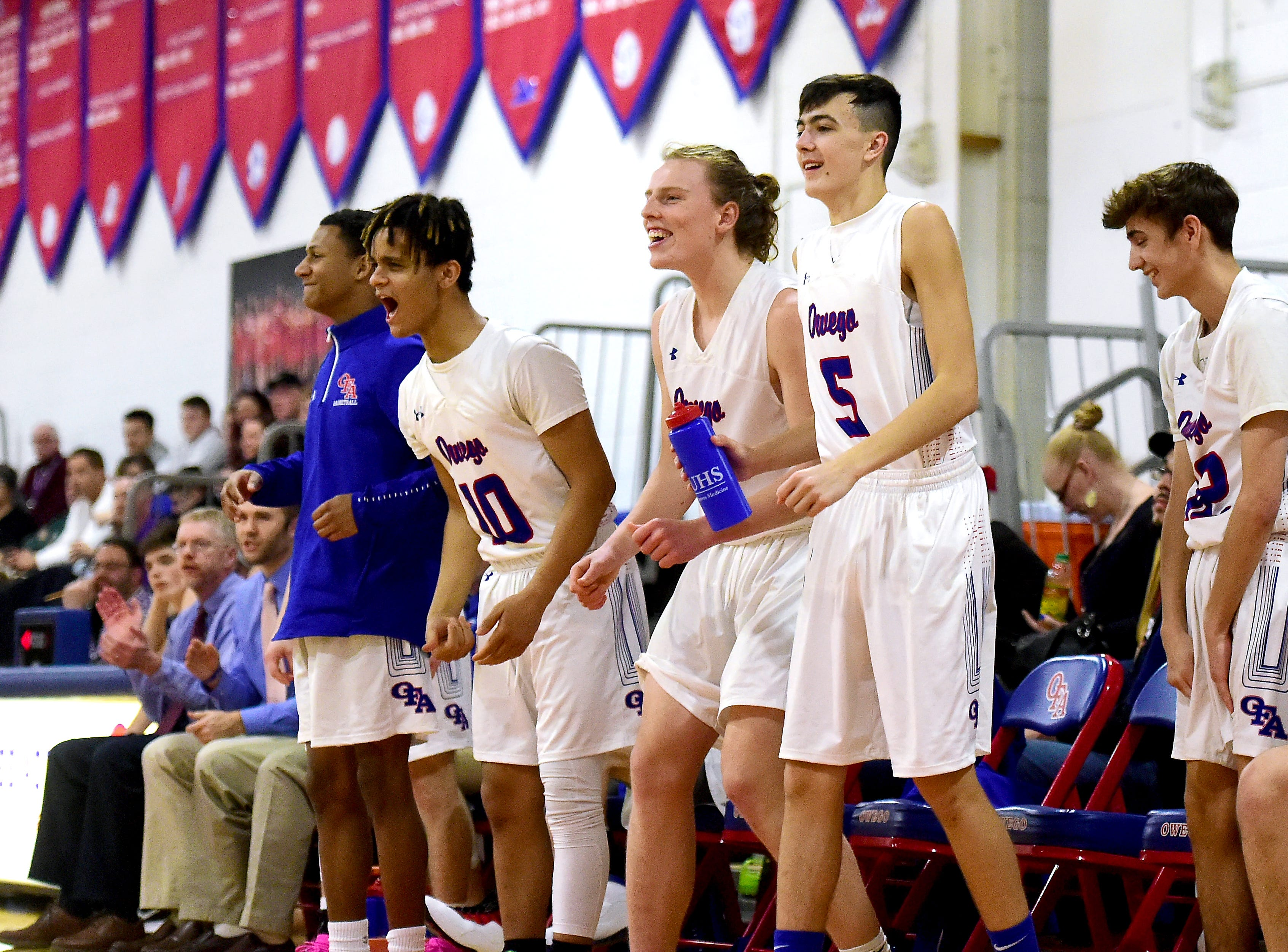 The Owego bench cheers on the team during the second half of Section 4 boys basketball, Class B quarterfinal. Dryden at Owego Free Academy, February 22, 2019.