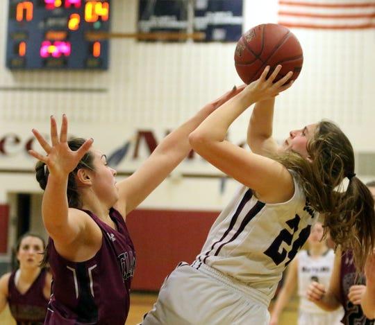 Taylor Kelly of Watkins Glen puts up a shot as Delhi's Anna Post defends during a Section 4 Class C girls basketball quarterfinal Feb. 22, 2019 at Watkins Glen High School.