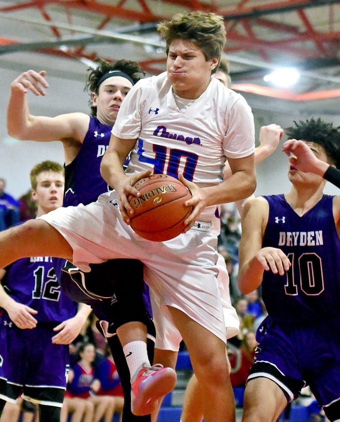 Owego's Nick Waysin (24) captures a rebound during the second half of Friday's  Section 4 boys basketball Class B quarterfinal, Dryden at Owego Free Academy, February 22, 2019.