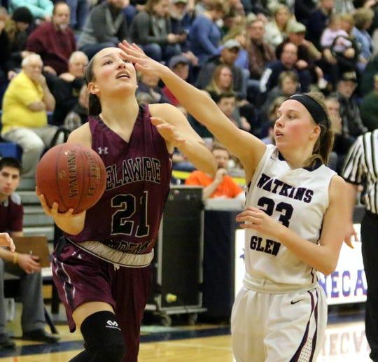 Sylvia Liddle of Delhi puts up a shot as Danielle Leszyk of Watkins Glen defends during a Section 4 Class C girls basketball quarterfinal Feb. 22, 2019 at Watkins Glen High School.
