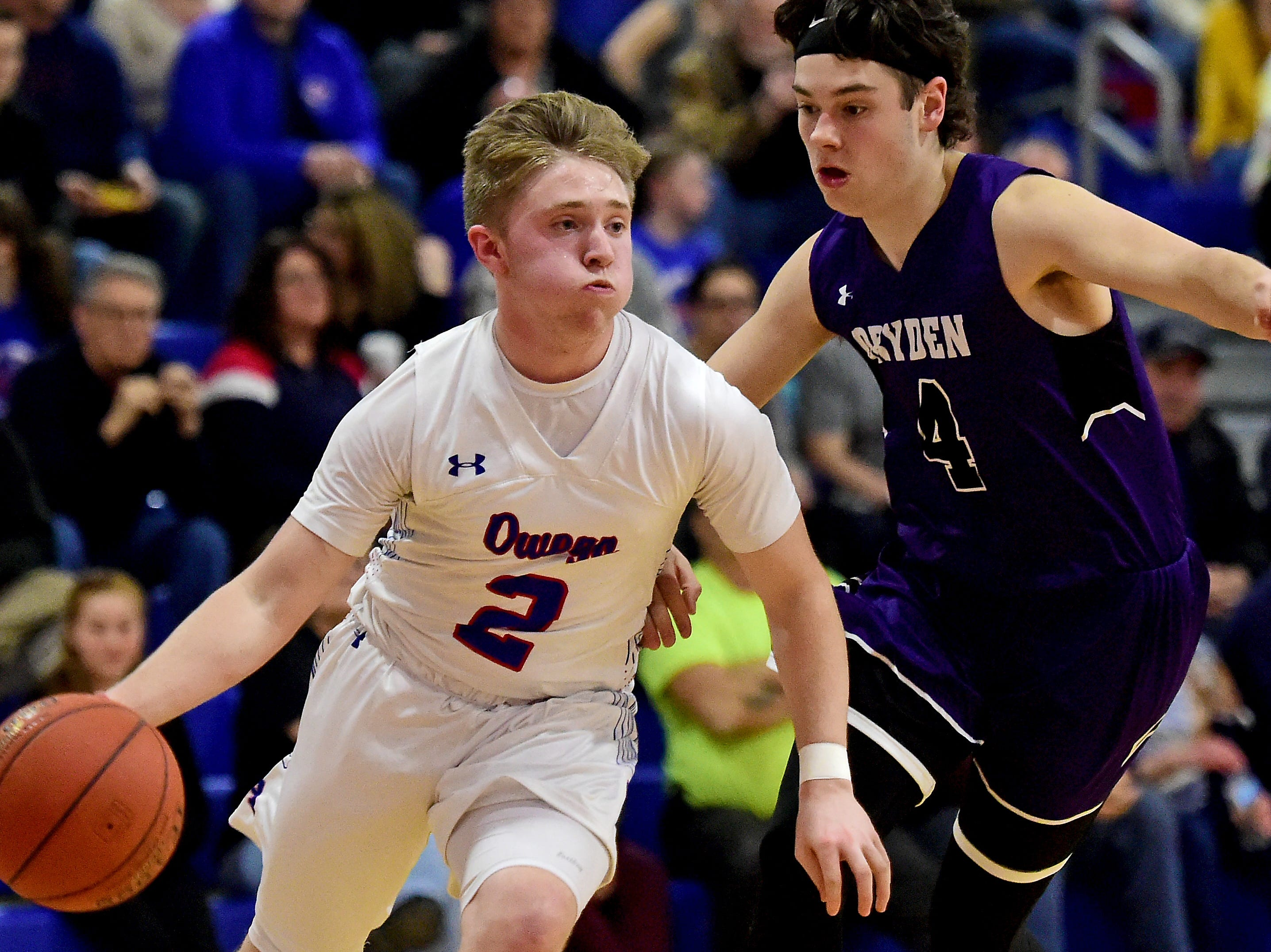 Owego's Nate Bennett (2) looks to get by Dryden during Friday's Section 4 boys basketball Class B quarterfinal, Dryden at Owego Free Academy, February 22, 2019.