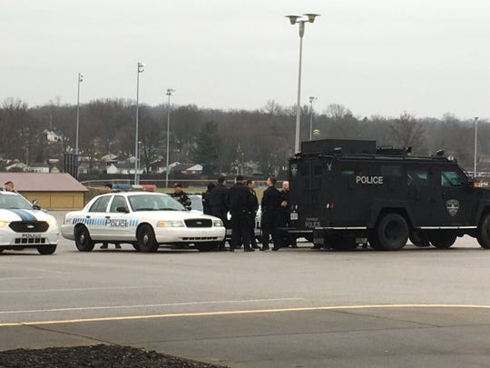 A heavy contingent of Evansville police with heavy equipment are at Central High School two hours before Drag Queen Story Hour at North Park library.
