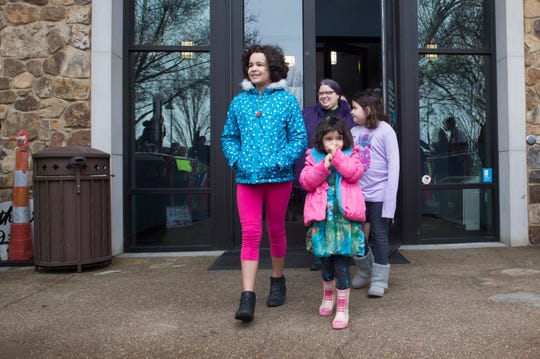Parents and children exit North Park Library after EVPL's Drag Queen Story Hour Saturday, Feb. 22, 2019.