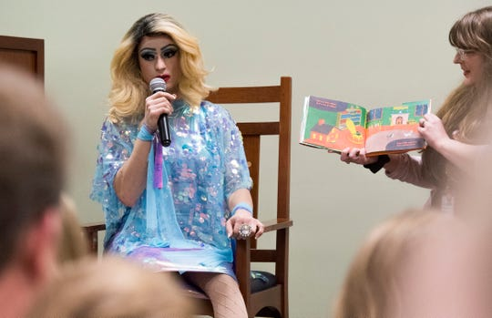 EVPL's Drag Queen Story Hour performer Florintine Dawn reads Goodnight Moon to children at North Park Library Saturday, Feb. 23, 2019.