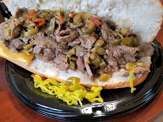 Black slow-cooks sliced beef with peppers and giardiniera for her Italian beef sandwiches.