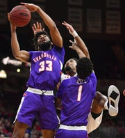 Evansville's K.J. Riley (33) and Marty Hill, right, grab a rebound from Bradley's Dwayne Lautier-Ogunleye during an MVC game at Carver Arena on Saturday.