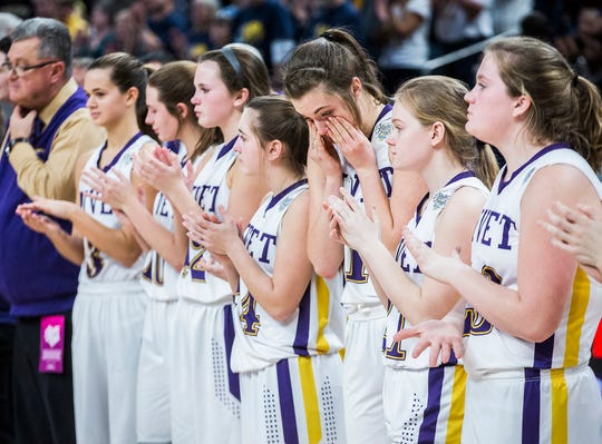 Vincennes Rivet reacts after losing to Marquette Catholic 57-36 in their state final game at Bankers Life Fieldhouse Saturday, Feb. 23, 2019.