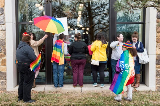 "LGBTQ supports stand in front of the windows around the children's play area at North Park Library while the EVPL's Drag Queen Story Hour was taking place Saturday, Feb. 22, 2019.  One said ""they were blocking the children from the haters."""