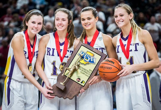 Vincennes Rivet senior Grace Waggoner (far right) poses with her teammates after losing to Marquette Catholic in the state championship.