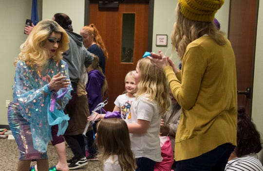 EVPL's Drag Queen Story Hour performer Florintine Dawn dances with children in the first session Saturday, Feb. 23, 2019.