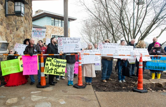 People protest the EVPL's first Drag Queen Story Hour event outside North Park Library in Evansville, Ind. Saturday, Feb. 23, 2019.