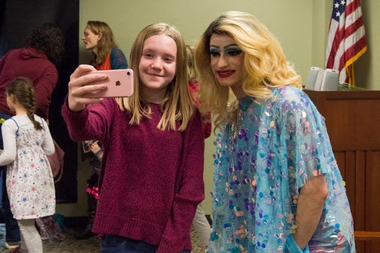 Lorelei Taylor takes a selfie with Florintine Dawn after during EVPL's Drag Queen Story Hour at North Park Library Saturday, Feb. 22, 2019.