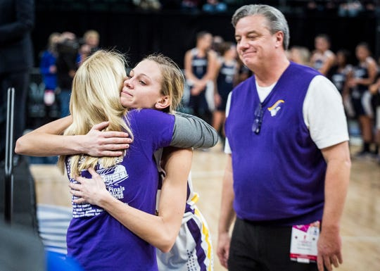 Vincennes Rivet senior Grace Waggoner hugs her mother, Kristi, after receiving the Mental Attitude Award after the Class 1A state championship.
