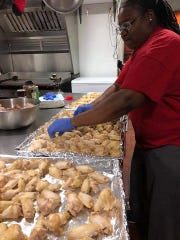 LaShell Black preparing chicken wings for the Evansville WingFest 2019.