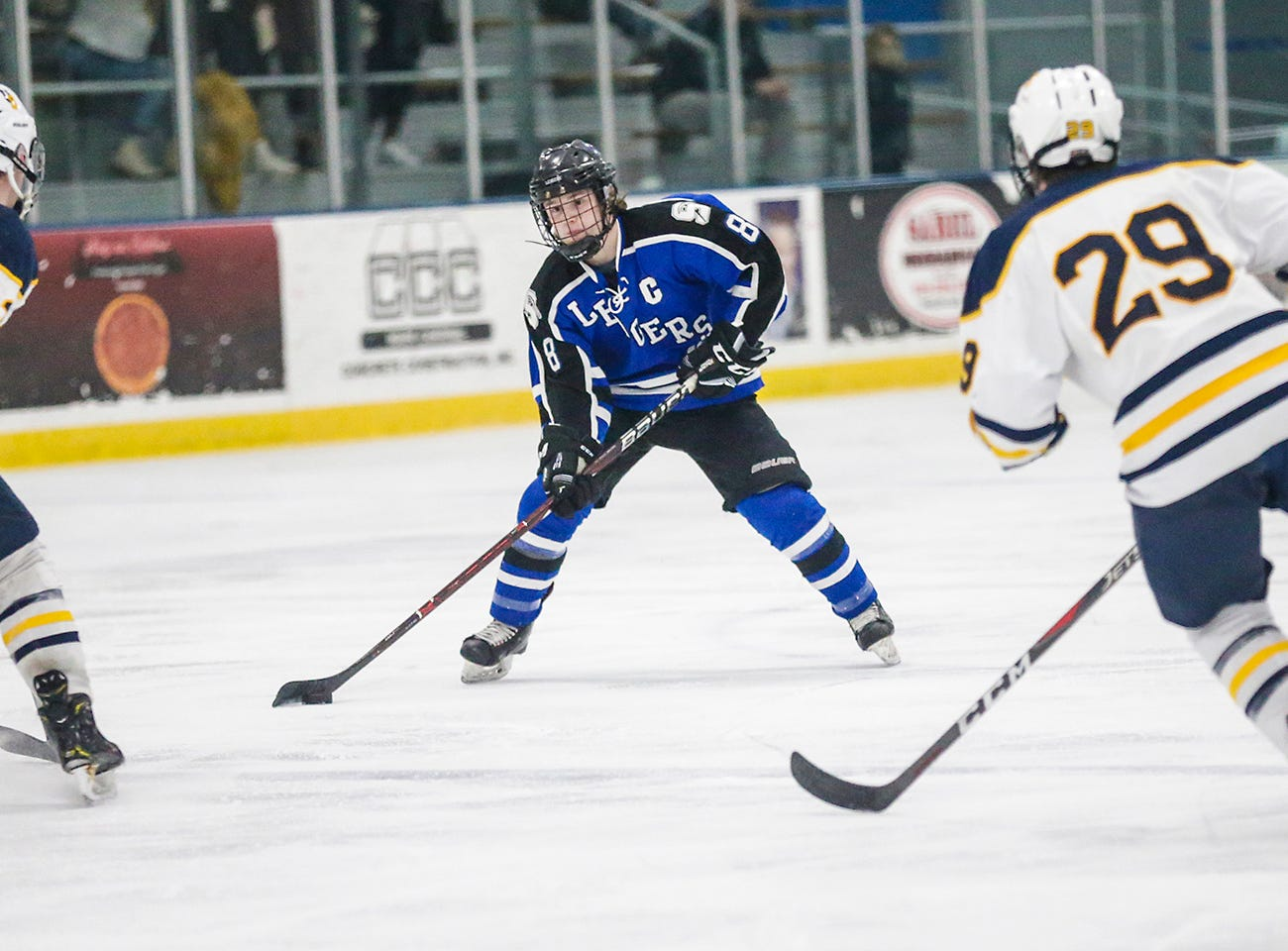 St. Mary's Springs boys co-op hockey's Zach Welsch (8) is defended by University School of Milwaukee's Robby Newton (13) and Alex Thundercloud (29) Friday, February 22, 2019 during their WIAA sectional final game in Fond du Lac. University School won the game 6-1 and will advance to state. Doug Raflik/USA TODAY NETWORK-Wisconsin